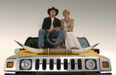 Gary Cowger and his wife Kay sit on top of a Hummer H2