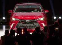 Photographers photograph the new 2015 Toyota Camry as it's revealed at 2014 New York International Auto Show, Wednesday, April 16, 2014. The best-selling car for 12 straight years, 10.2 million sold, with more than 6 million still on the road, Toyota stripped down the Camry to its chassis and rebuilt it from the ground up. Photo: Joe Polimeni
