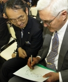 General Motors Vice Chairman Robert Lutz (R) sketches a motorcycle as Subaru Chairman Kyoji Takenaka looks on during GM's press conference in Tokyo, Japan Wednesday October 22, 2003 for the opening of the Tokyo Motor Show.Photo: Joe Polimeni/General Motors