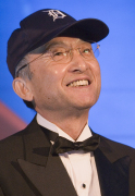 """Katsuaki Watanabe, President of Toyota Motor Corporation, is all smiles as he wears a Detroit Tigers' baseball cap prior to his keynote address to the Society of Automotive Engineers World Congress in Detroit, Michigan, Thursday April 19, 2007. """"It's engineers like Thomas Edison, and all of you in this room, together with your colleagues around the globe who are solving problems and making this world a better place for all of us to live. Photo: Joe Polimeni/Toyota"""