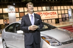 Jim Farley, Group Vice President, Marketing – Toyota Motor Sales, USA, is all smiles standing next to the Prius Hybrid at Toyota's display at the New York International Auto Show, Wednesday April 4, 2007. Boosted by record hybrid sales, Toyota's Prius posted all-time best-ever monthly sales of 19,156 for March, a 133.2 % increase from last year. Sales of Toyota and Lexus hybrids have now topped the half-million mark. Photo: Joe Polimeni/Toyota