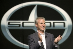 Jack Hollis, Vice President of Scion applauds after unveiling a New Dimension of Scion at the New York International Auto Show, Wednesday, March 31, 2010 with the all-new 2011 iQ premium micro subcompact, and the second generation 2011 tC sports coupe. The tC is scheduled to arrive in dealerships later this fall, while the iQ will go on sale early 2011.