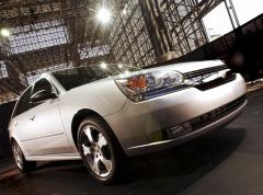 The 2004 Chevy Malibu Maxx awaits its worldwide introduction at Jacob K. Javits Glass Palace