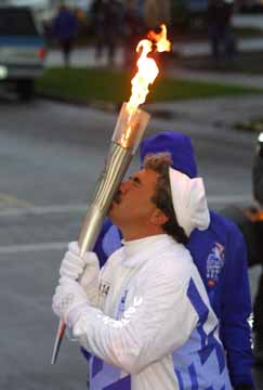 Joe Polimen runs with the Olympic Torch