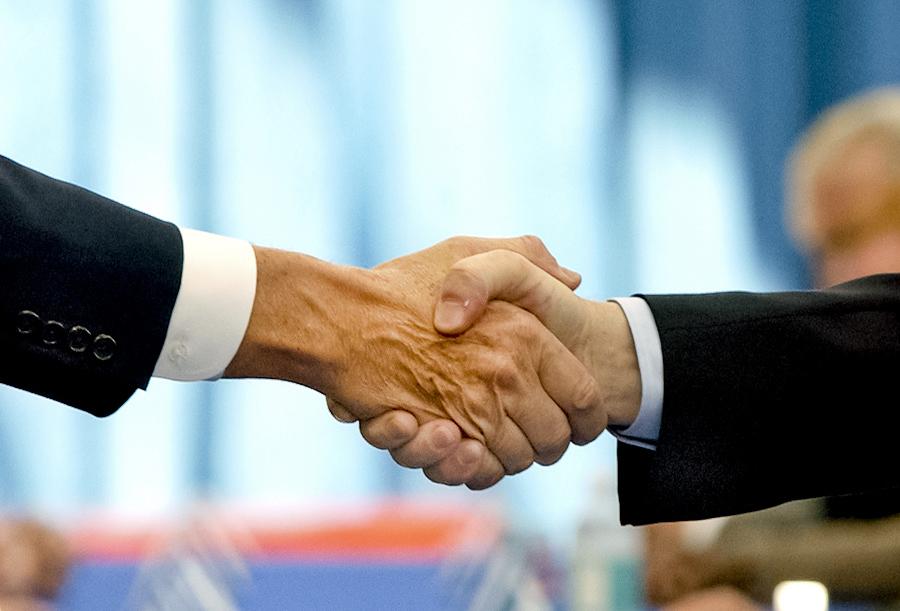 """GM UAW handshake By: Joe Polimeni"""